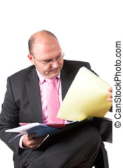 Organizing his files - Businessman organizing his files in...