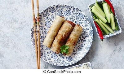 Orginal asian deep fried spring rolls placed on beautiful...