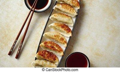 Orginal asian dumplings gyoza served in long plate with soy...