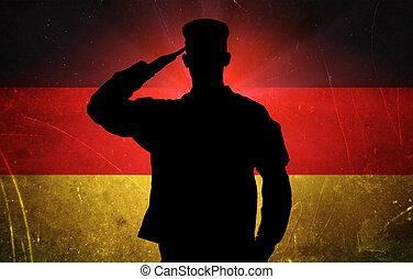 orgulloso, alemán, soldado, en, bandera alemana, plano de fondo