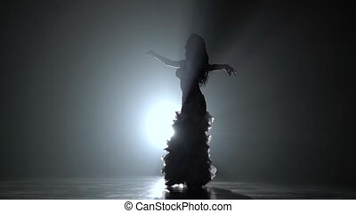 Beautiful traditional oriental belly dancer. Smoke background