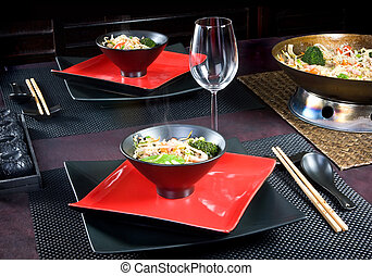 Oriental food - Traditional table setting with oriental wok...