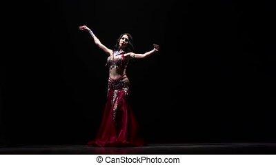Oriental girl dancing . Black background. Slow motion -...