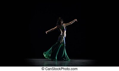Oriental girl dancing on black background