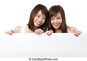 Oriental girls with blank sign