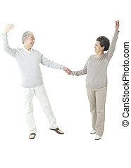Oriental old couple dancing