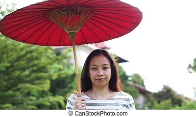 oriental red umbrella with asian girl