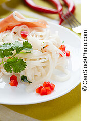 Oriental rice vermicelli on a white plate