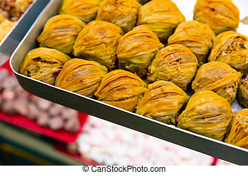 Traditional turkish dessert baklava with peanuts on a metal tray