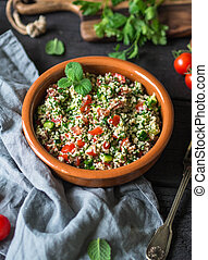 Oriental tabbouleh salad with couscous, vegetables and herbs...
