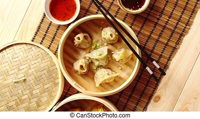 Oriental traditional chinese dumplings served in the wooden...