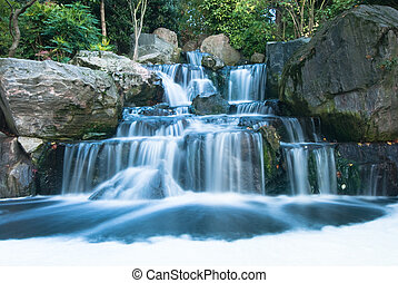Oriental waterfall landscape - Cascading waterfall with ...