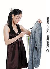 oriental woman checking sales tag