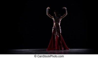 Oriental woman dancing . Black background. Slow motion -...