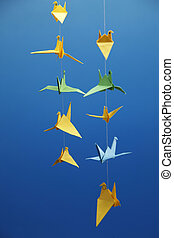 origami -bird - many of origami bird hanging  in a row