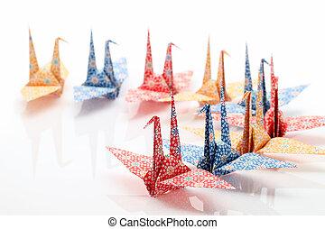 Origami birds on white background