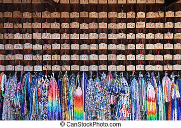 Origami cranes and prayer tablets at Fushimi Inari Shrine in Kyoto, Japan