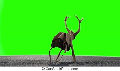 Origami deer on green screen. Animal made from paper on...
