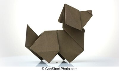 Origami dog close up. White isolated background.