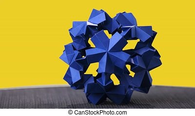 Origami floral ball on colorful background. Blue spherical...