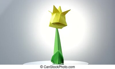 Origami flowers over white background. Yellow flower with...