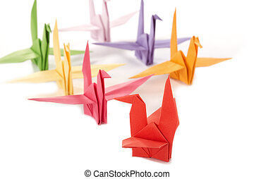 Origami - Japanese toys from a paper on a white background.