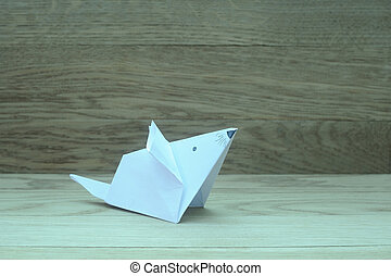 origami mouse on wooden background