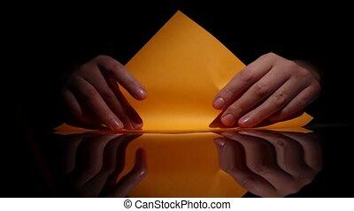 Origami of yellow paper. Black. Closeup - Origami of yellow...