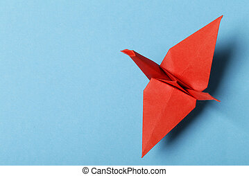origami paper crane on a blue background
