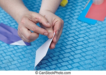 Origami paper pensil - Pencil of origami color paper on a ...
