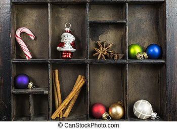 vintage type case with christmas ornaments