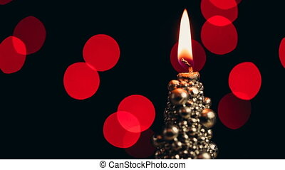 Original christmas candle burning on a bokeh background....