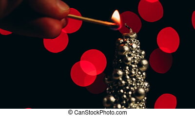 Original christmas candle set fire to a match. Close up...