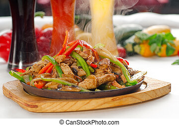 original fajita sizzling hot on iron plate - original fajita...