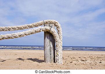 original ropes fence on sea beach