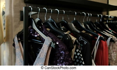 Original things for women hang on a hanger in a fashionable...