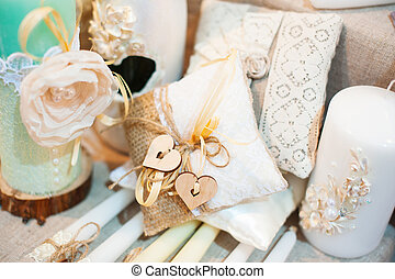 Original wedding decoration in the form of mini-vases and bouquets of flowers on ceremony.
