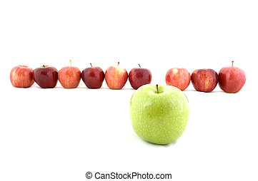 Originality - A green apple stands out from the crowd, a...