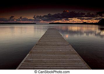 Orillia Dock - Dock on a lake at sunset