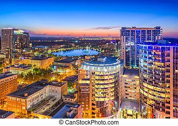 Orlando, Florida, USA aerial cityscape towards Eola Lake.