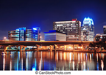 Orlando Lake Lucerne panorama at night with office buildings...