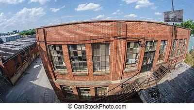 orld brick building in abandoned neighborhood alley