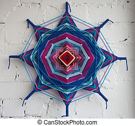 Ornament Mandala from thread - Mandala woven with threads on...