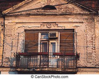 Ornamental balcony on a old run down house