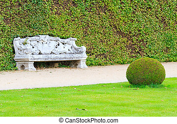 Ornamental English garden with stone bench