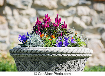 Ornamental flowerpot full of flowers