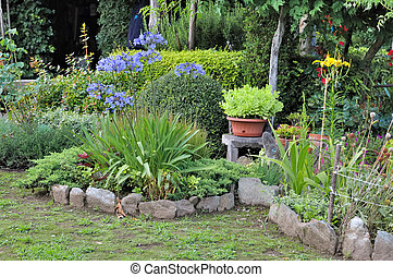 garden with borders and flower beds and pots