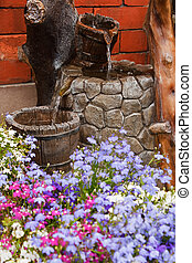 ornamental garden water feature - small residential paved...