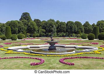 Water fountain in beautiful ornamental garden in Vienna, Austria
