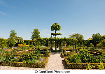Ornamental garden with arcs and a path